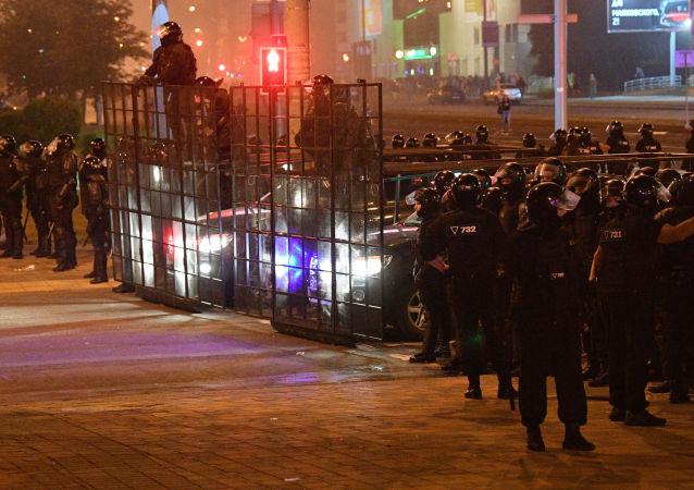 卫星通讯社白俄罗斯分社记者报道明斯克骚乱时被捕并遭到殴打