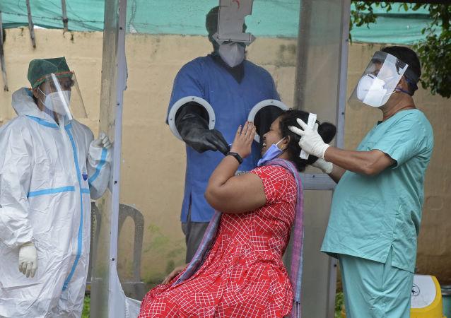 印度单日新增新冠病毒感染病例创纪录
