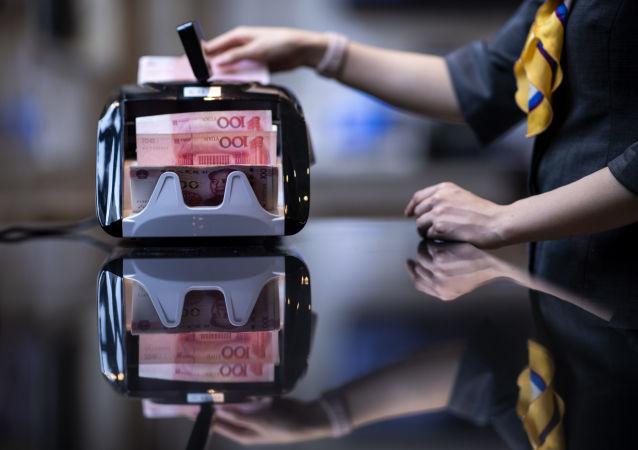 外媒:中国央行呼吁更多使用现金