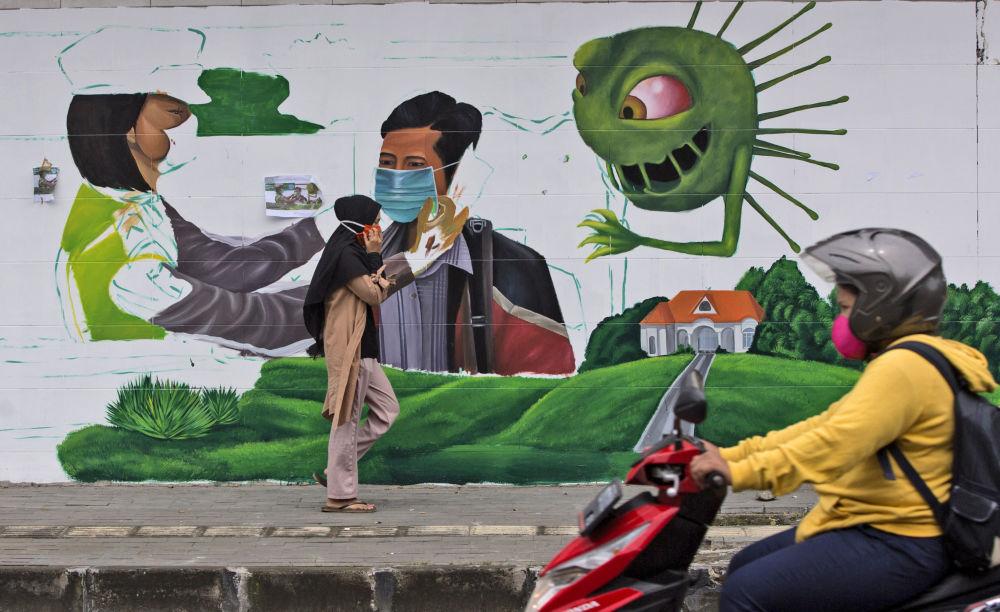 苏门答腊岛一副提醒戴口罩的涂鸦