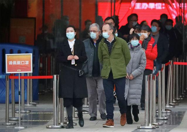 世卫组织专家在武汉