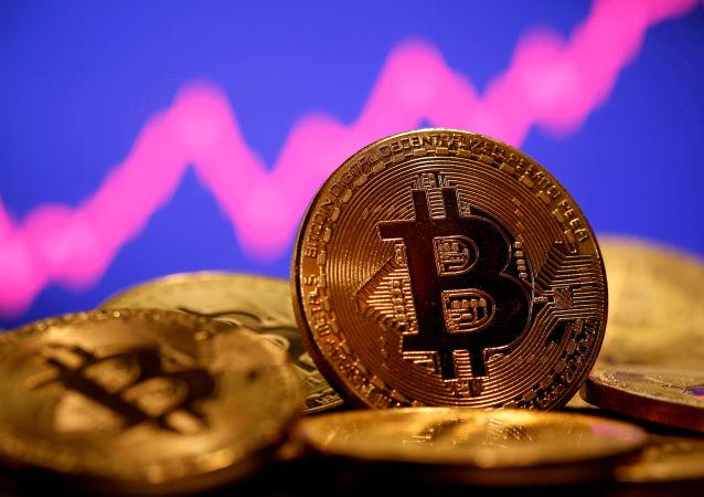 比特币价格一个月来首次打破历史纪录达到6.23万美元
