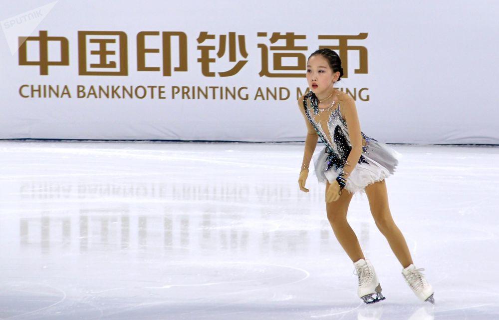 花滑运动员参加在首都体育馆举行的北京冬奥会冰上项目测试赛花样滑冰比赛。
