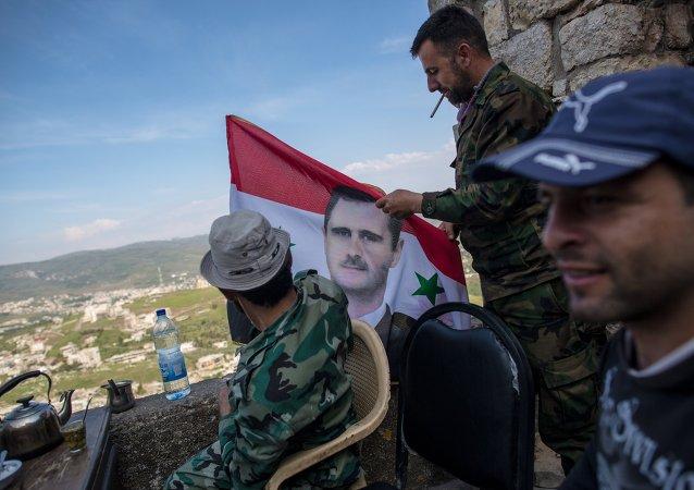 叙利亚总统在大马士革东郊前线迎接新年