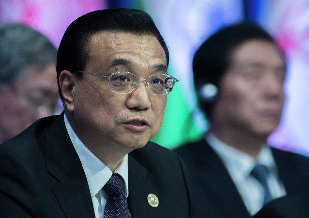 中国国务院总理:中国决不打贸易战和货币战