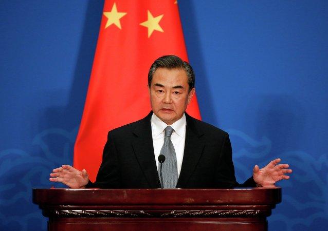 中国外长:中国永远不会把贸易问题政治化