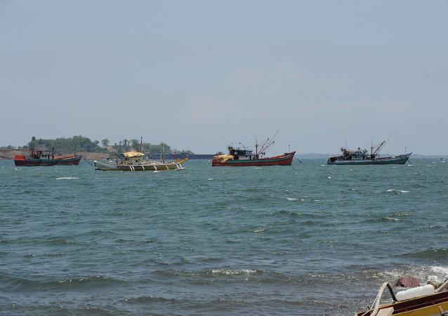中国要求菲律宾不要在南海争议海域从事渔业活动