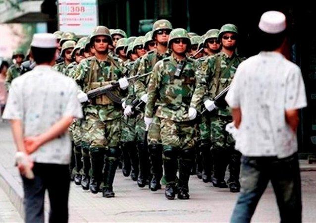 """中国官员: """"去极端化""""是新疆突出紧迫的任务"""