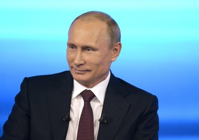 普京呼吁远离对峙 维护世界体育团结
