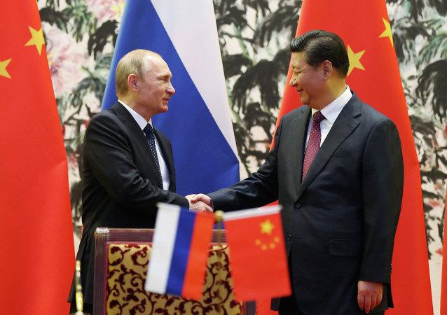 普京:俄中关系达到前所未有的高水平