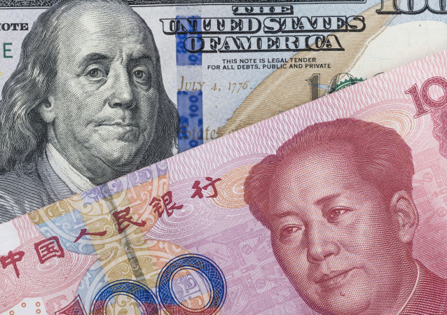 专家:中国央行下调人民币汇率或为迫使美联储推迟提息