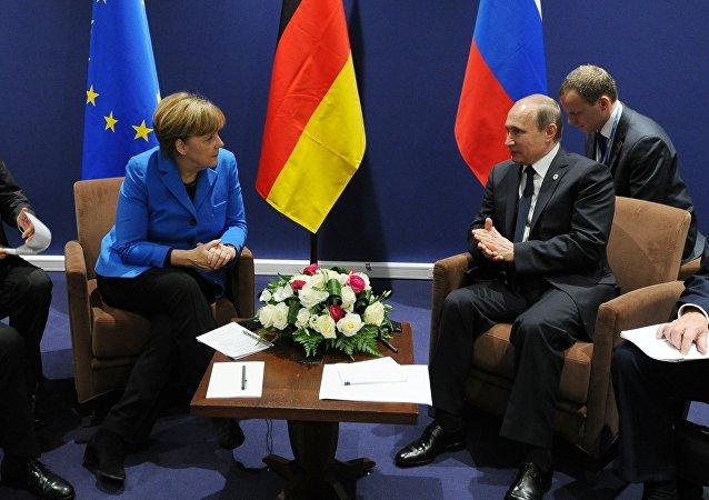 普京与德国总理以及欧盟委员会主席在巴黎气候大会期间进行会谈