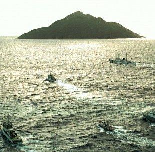 日本因中国船只进入争议岛屿海域对华提出抗议