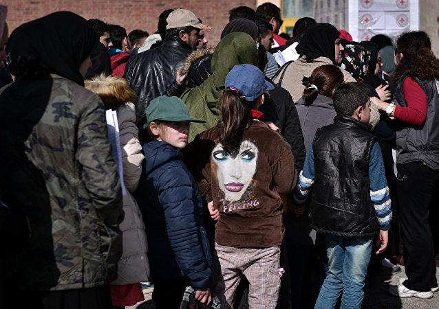 欧盟呼吁各国分担移民危机的义务