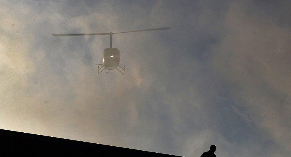 一架直升机在俄阿尔泰坠毁 搜救人员将把特种水下搜索设备将运往事发地