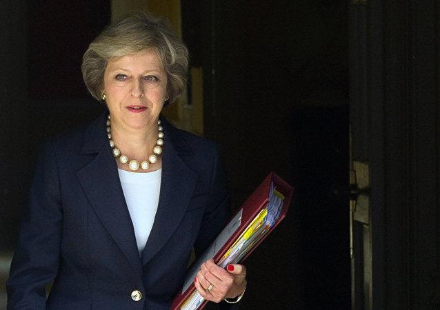 英国首相就职一个月后赴瑞士度假