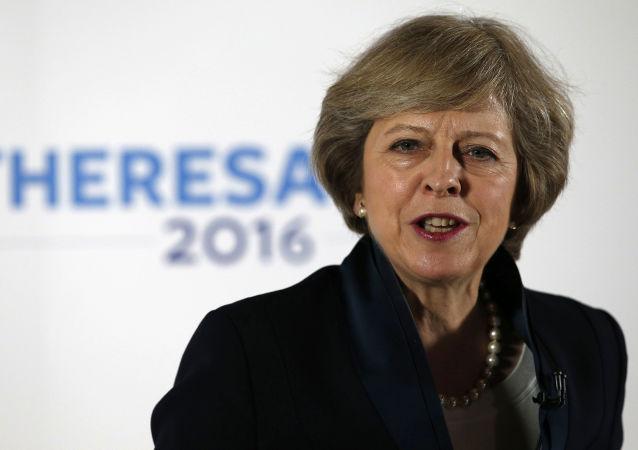 英国首相:英方愿同中方促进全球自由贸易