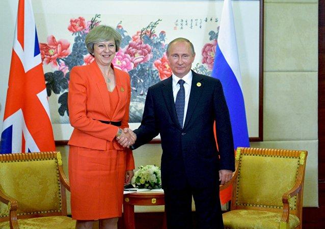 俄经济发展部长:普京与梅商讨叙利亚与反恐等问题
