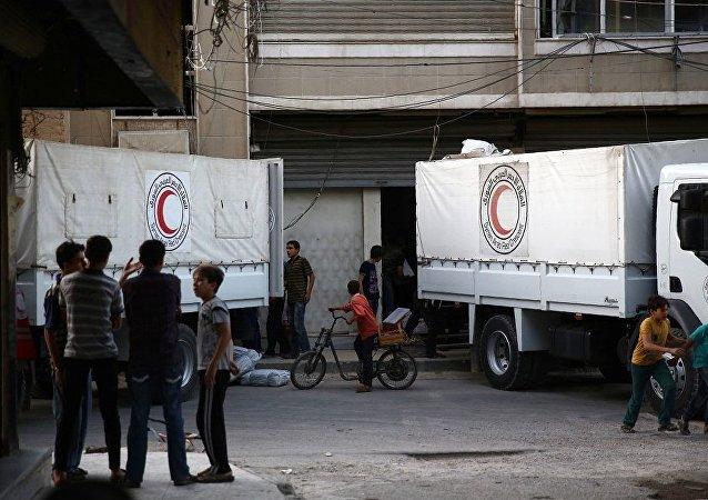 联合国人道援助车队进入叙利亚穆阿达米亚市内