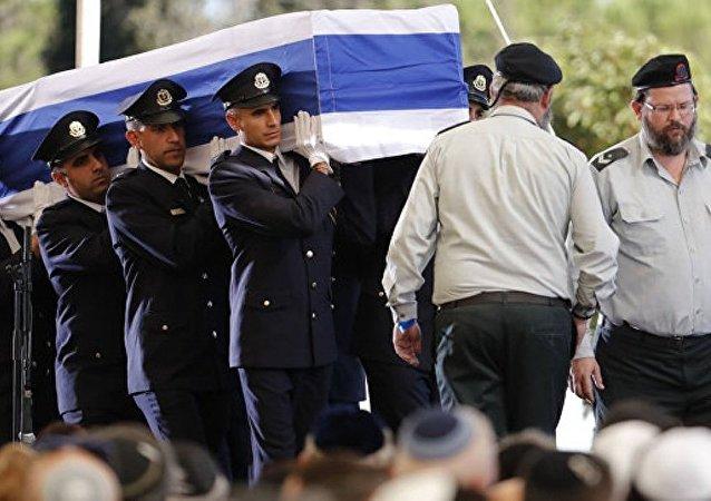 巴以领导人在佩雷斯葬礼前短暂交谈