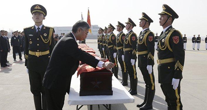 韩国归还20多具志愿军遗骸