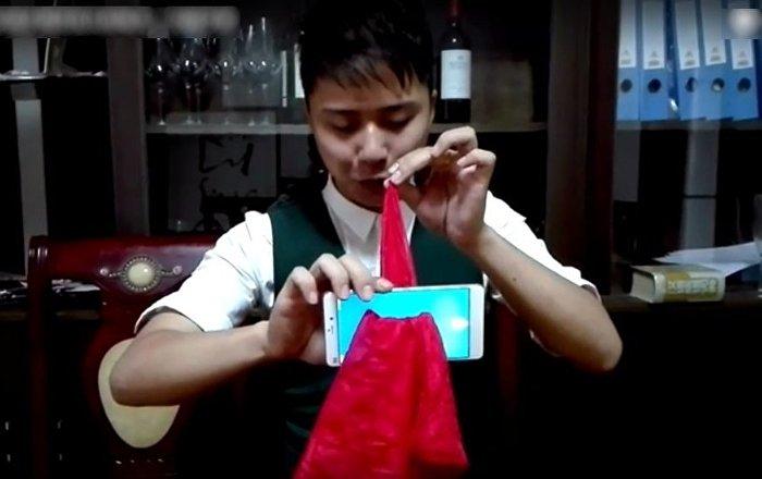 魔术揭秘 丝巾穿越手机背后真相曝光 一分钟学会