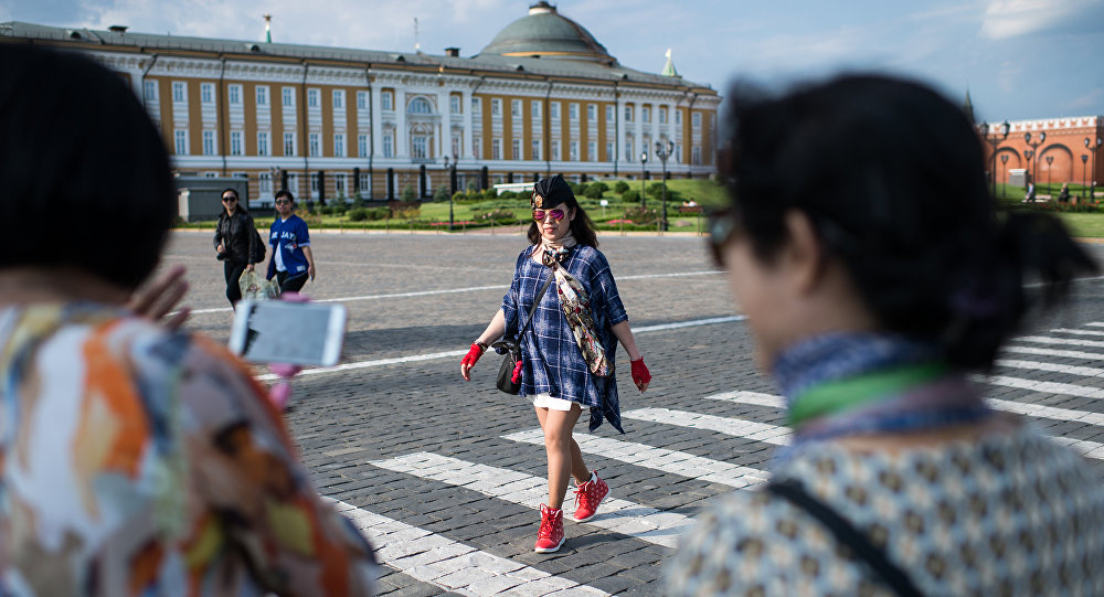 Chinese tourists on the territory of the Moscow Kremlin