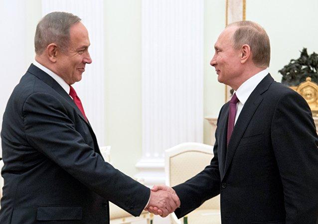 以色列总理内塔尼亚胡(左)和俄罗斯总统普京