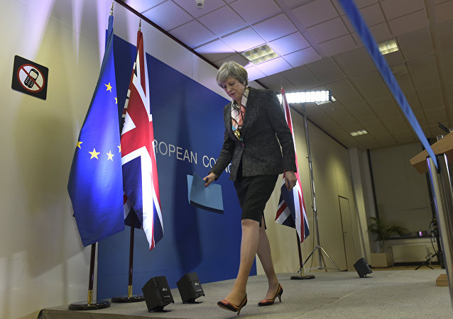 British Prime Minister Theresa May leaves after a press conference during a European Summit