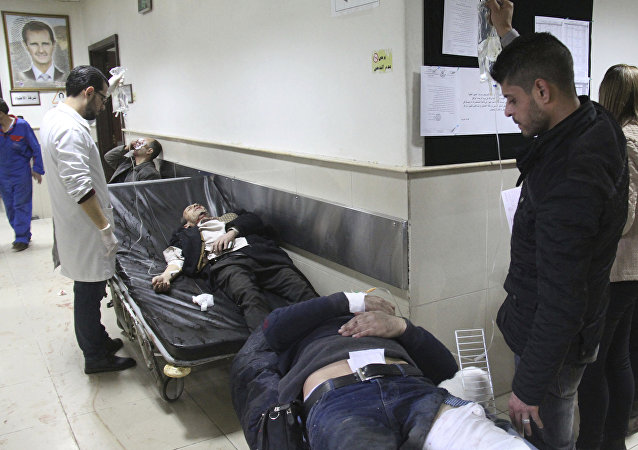 Syrian injured men wait to receive medical treatments after they wounded in the main judicial building which attacked by a suicide bomber, in Damascus