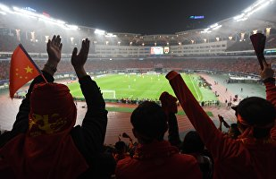 Chinese fans celebrate their World Cup football qualifying win against South Korea