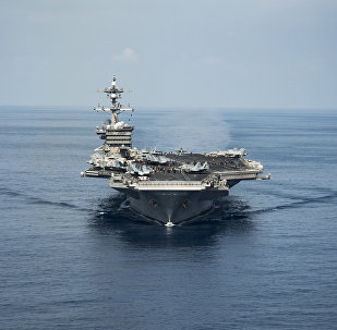 The aircraft carrier USS Carl Vinson transits the South China Sea