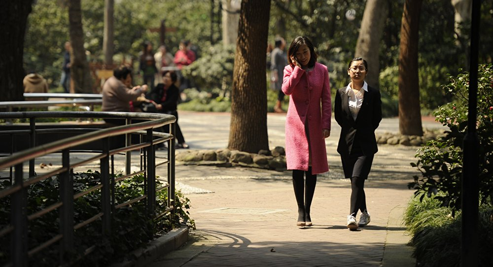 People enjoy spring weather in a park in Shanghai