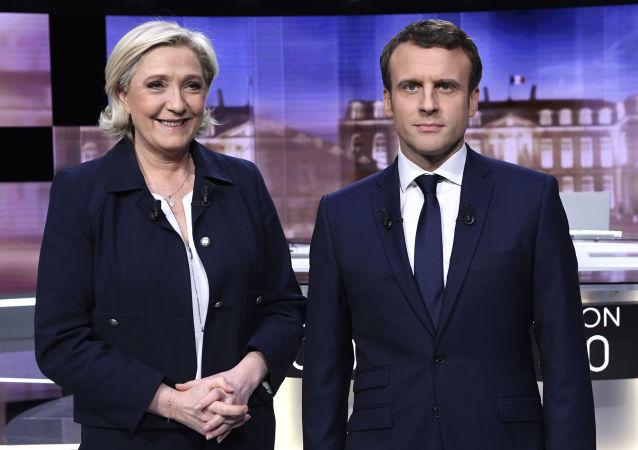 法内政部:马克龙以66.1%得票率在法大选第二轮投票中获胜 勒庞得票率为33.9%