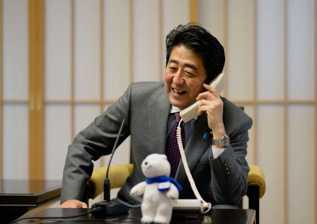 日本首相祝贺普京在总统选举中获胜
