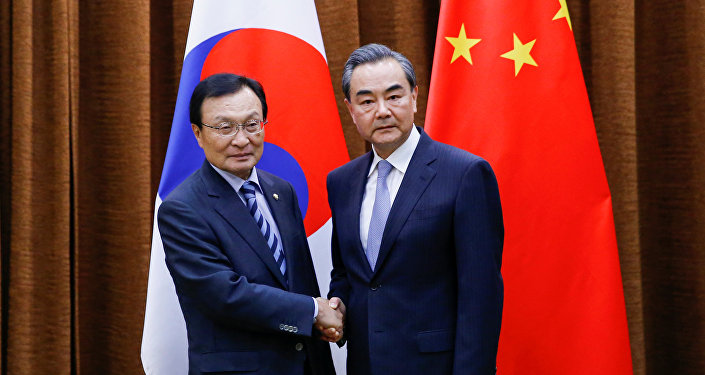 Chinese Foreign Minister Wang Yi meets South Korean special envoy Lee Hae-chan at the foreign ministry in Beijing