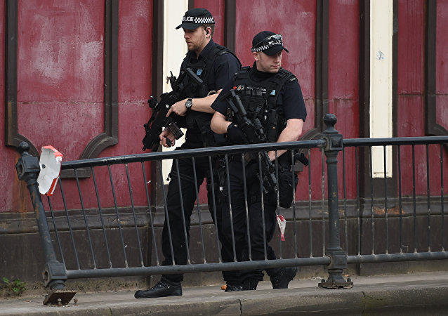 Armed police patrol near Victoria station in Manchester, northwest England