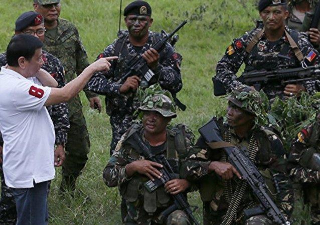 菲总统:可通过对话解决与极端分子的冲突