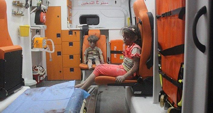 """奥姆兰一家将留在阿勒颇支持阿萨德 曾被称作""""叙利亚平民苦难的缩影"""""""