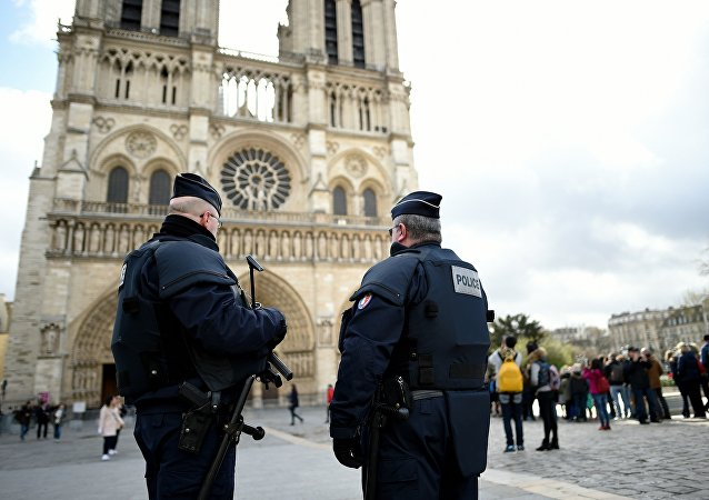 French Police officers patrol outside the Notre-Dame cathedral