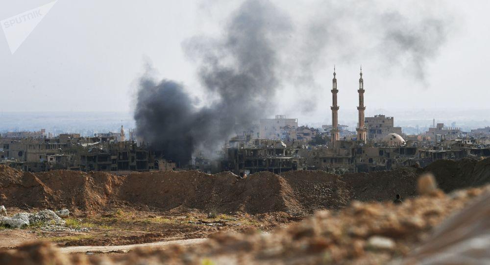 国际联军空袭叙利亚拉卡市 致一家8人死亡