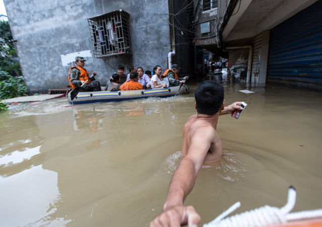 华南的洪水和暴雨造成26人死亡,8人失踪