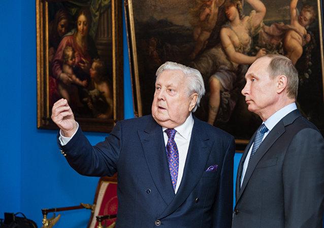 俄罗斯总统普京和著名画家伊利亚·格拉祖诺夫/资料图片/
