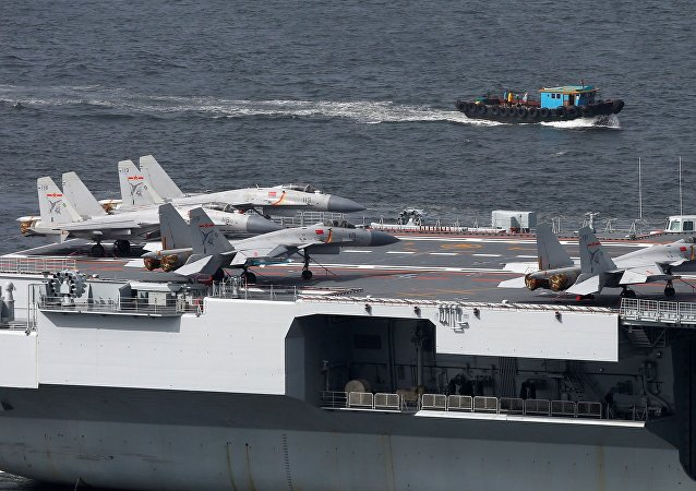 Fighter jets and helicopters are seen on board China's aircraft carrier Liaoning as it sails into Hong Kong
