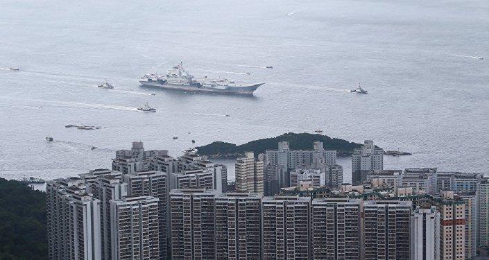 China's first aircraft carrier Liaoning sails into Hong Kong on its maiden visit to Hong Kong