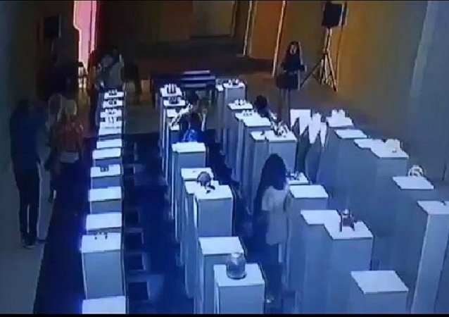 Woman Tries To Take Selfie At Gallery, Knocks Down $200,000