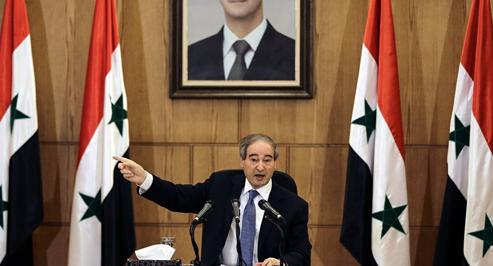 Syrian Deputy Foreign and Expatriates Minister, Faisal Mikdad, speaks at a press conference