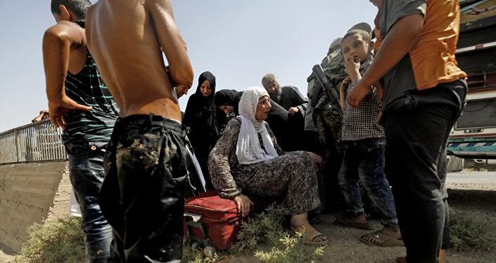 美国主导国际联盟在叙空袭导致约20人死亡