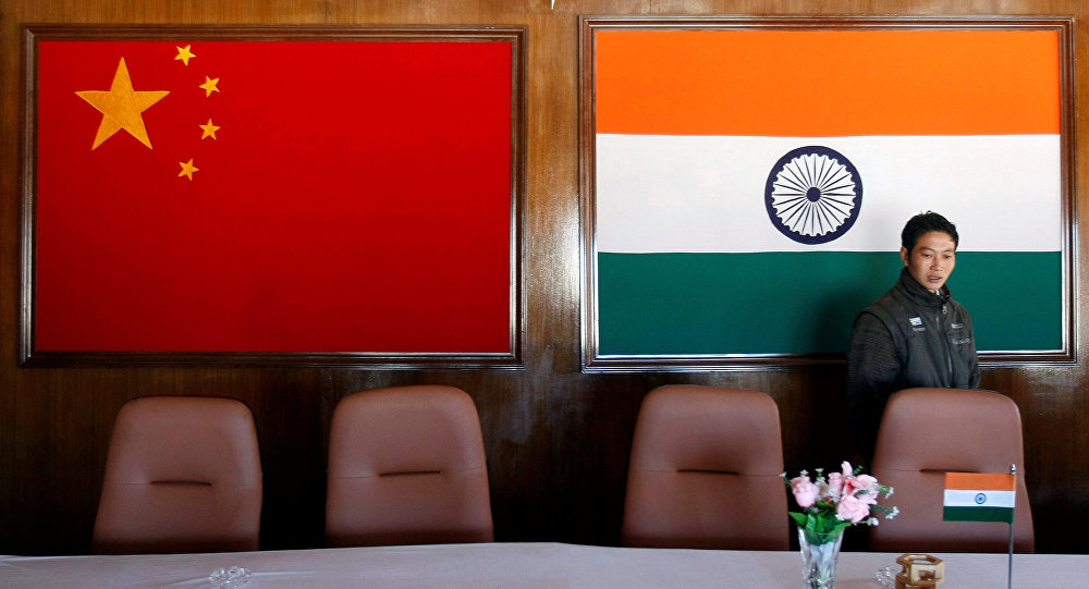 A man walks inside a conference room used for meetings between China and India