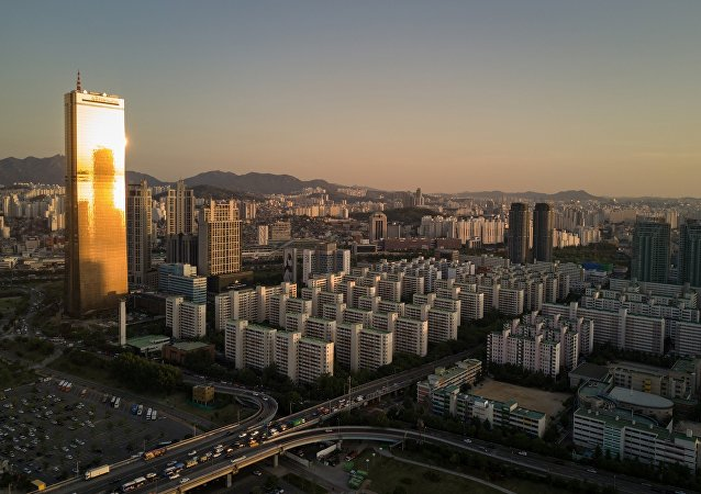 A general view shows apartment buildings surrounding the 63 tower (L) in Seoul